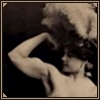 rydra_wong: 19th-C strongwoman and trapeze artist Charmion flexes her biceps while wearing a marvellous feathery hat (strength -- strongwoman)