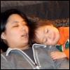 kate_nepveu: toddler pretending to sleep on adult's shoulder (SteelyKid - cuddling with Mom (2011-03))