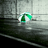 skieswideopen: A green-and-white umbrella sits on the ground (Umbrella)