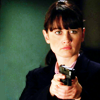 skieswideopen: Teresa Lisbon against a green background, aiming a gone (Mentalist: Lisbon with gun)