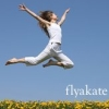 flyakate: woman leaping in the air, with flyakate written in white text (Fly fly a kate)