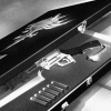 leonhart: black & white image of squall's gunblade & case from opening credits (revolver)