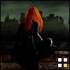 ree: rear view of woman viewing urban ruins (JJ faceless)
