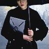 longwhitecoats: Mako Mori holding a file to her chest and raising an umbrella over her head (Mako)