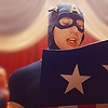 longwhitecoats: Captain America in his 1940s costume reading aloud from the notes on the back of his shield (Steve reading)