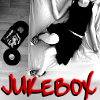 "morbane: woman sprawled on bed next to vinyl record, text ""jukebox"" (headphones, Jukebox)"