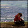 annalee: A picture of me on top of Pendle Hill, writing in my notebook. (Always Writing)