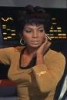 azurelunatic: Lt. Uhura in gold uniform, touching her headset.  (communications)