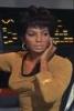 azurelunatic: Lt. Uhura in gold uniform, touching her headset.  (Uhura, communications)
