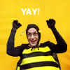 community_tv: dean pelton in a bee costume, holding his arms up in triumph; text: yay! (Default)