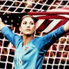 highways: [Footballer Hope Solo, holding the American unfurled behind her.] (FOOTBALL ☌ hope solo.)