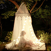 majoline: girl in a tent with fairy lights strung around the perimeter (tent light)
