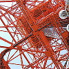 down: A view of the orange strutwork of Tokyo Tower from below (Tower)