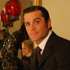 delphi: A screenshot of Det. William Murdoch from Murdoch Mysteries in an ornate sitting room. (murdoch)
