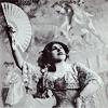 inevitableentresol: lady in Edwardian dress holding a fan (fan lady Edwardian music hall)