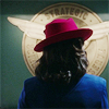 nenya_kanadka: Agent Peggy Carter in red hat in front of agency logo (MCU Agent Carter)