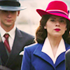 such_heights: peggy carter in red, white and blue in a crowd of grey suits (mcu: peggy [crowd])