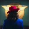 sixbeforelunch: peggy carter facing away from the camera in a red hat standing in front of the shield logo (mcu - peggy in her red hat)
