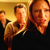 mortalcity: Olivia looking stunned and angry, with Walter and Peter behind her. (Fringe | catching bullets in our backs)