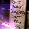 "frith_in_thorns: Sign reading ""Really really dangerous don't touch - McKay"" (SGA Danger sign)"