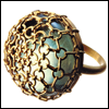 skywardprodigal: gold netted ring with light green stone (bling-how did you afford these? (House o)