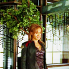 muccamukk: Teyla standing outside on Atlantis, with many plants in the background. (SGA: Garden)