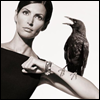 skywardprodigal: crow perched on an elegant woman's arm (raven is a crow is a black bird - irek k)