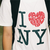 """proper_false: male wearing an """"I have never been to NY"""" T-shirt (I have never been to NY)"""