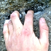 out_of_my_head: A weather-beaten, scraped-up and chilled hand on a gritstone hold. (hand)