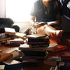 creascendo: Woman sitting, surrounded by books. (Stock - Reading)