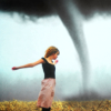 mortalcity: A girl in a field with arms outstretched, a tornado in the distance (stock | my love I am the speed of sound)