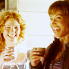 schneefink: Teyla and Sora with drinks, laughing (SGA Teyla and Sora cheerful)