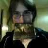 """eateroftrees: Emily with the album booklet from the Opeth album """"The Candlelight Years"""" sandwiched between her nose and upper lip (silly)"""