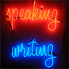 lightreads: the word speaking in handwriting-like red neon above the word writing in handwriting-like blue neon; (speaking writing)