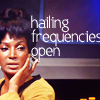 "metatxt: lieutenant uhura posed at the ready, text reads ""hailing frequencies open"" (tos: hailing frequencies open)"