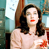 metatxt: darlene kursky (jadzia dax) gazes offscreen, holding a red teacup that matches her lipstick perfectly (ds9: tea)