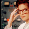 metatxt: jadzia dax wearing hipsteresque tortiseshell glasses, holding the edge of the frame (ds9: science glasses)
