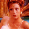 metatxt: hologram of kira nerys wearing a nightie with feather trim, making a pout (ds9: feathers and a pout)