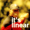"metatxt: captain benjamin sisko in baseball hat pointing with glove, text ""it's linear"" (baseball that is) (ds9: it's linear)"
