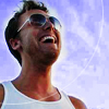 randomling: Lance Bass of *nsync, wearing shades and grinning, looks up and to the right. (lance shades)