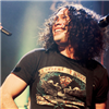 anoneknewmoose: man with curly hair grinning big (bandom - mcr ray has the BEST SMILE)