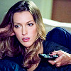 shopfront: Source: Arrow. Laurel kicked back on her couch with a remote in her hand, watching tv. (Arrow - [Laurel] hooked on the tube)