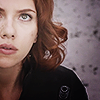 shopfront: Source: The Avengers. Black Widow in New York on the battlefield staring up at the sky/screen (AV - Bird? Plane? Black Widow movie?)
