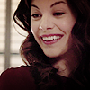 shopfront: Source: Teen Wolf. Jennifer Black in class, smiling down at a student in a very exaggerated over the top fashion (TW - [Jen] crazy under this smile)