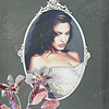 asharadayne: actress angelina jolie in an oval frame with a grey background, decorative flowers in a corner (angelina jolie (framed))