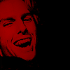"asharadayne: lestat de lioncourt from the film ""interview with the vampire"", entirely in red and black, laughing, fangs bared (lestat de lioncourt (laughing))"