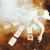 darwin: someone lying amidst a tarot spread (on the cards)