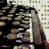 green: closeup edit of an old rusted typewriter with unreadable text in the background (stock: typewriter)