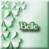 belle_meri: Scattering of shamrocks on a soft palest green background with my name on the icon (Default)