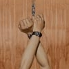 azurelunatic: Upstretched hands bound at the wrist and chained. (wrists)